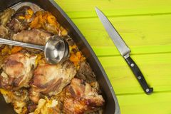 Casserole dish with pork on a wooden board. Homework communal meal. Royalty Free Stock Photography