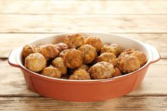 Casserole dish with sausage cheese balls. On wooden background Stock Photography