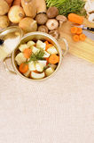 Casserole dish or stockpot with organic vegetables and kitchen chopping board, copy space, vertical Stock Photos