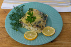 Casserole of fish and fresh cabbage. On a ceramic plate Royalty Free Stock Images