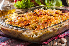 Casserole fusilli pasta with sausage, zucchini and cheese Royalty Free Stock Image