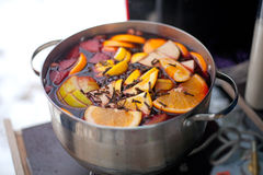 Casserole with hot wine, fruits and spices Royalty Free Stock Photo
