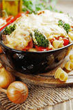 Casserole with meat, pasta, broccoli and tomatoes Stock Images