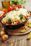 Casserole with meat, pasta, broccoli and tomatoes Royalty Free Stock Images