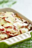 Casserole with meat, potato, tomato and cheese Stock Photos