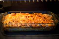 Casserole in oven. Casserole with cheese in oven Stock Photo