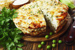Casserole of pasta with green peas, zucchini and curd Stock Photography