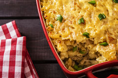 Casserole with pasta and white cabbage. On a dark wooden background Stock Photos