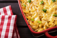Casserole with pasta and white cabbage. On a dark wooden background Stock Photo