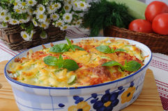 Casserole of pasta with zucchini Stock Images