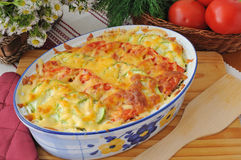 Casserole of pasta with zucchini and tomato with cheese Stock Photos