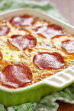 Casserole with pepperoni Stock Photos
