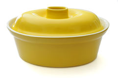Casserole Pot. A bright yellow ceramic casserole pot Royalty Free Stock Photography