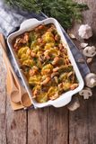 Casserole potato with bacon and mushrooms vertical top view. Casserole potato with bacon and mushrooms and cheese in baking dish. vertical top view Stock Images