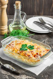 Casserole with potatoes, cheese, fresh green apple and lemon, se. Potato gratin with cream cheese and fresh herbs Royalty Free Stock Photo