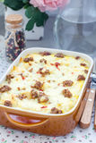 Casserole with potatoes, sausage and pepper, in baking dish, vertical Royalty Free Stock Photo