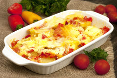 Casserole of potatoes  with zucchini and carrots and cheese Stock Photography