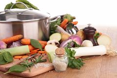 Casserole and raw vegetables Royalty Free Stock Image