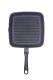 Casserole revêtue de téflon de gril d'isolement sur le blanc photographie stock