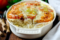Casserole with rice, sea bass, tomato. And cheese stock photos