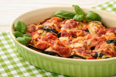Casserole with roasted eggplants stuffed with minced meat. Stock Photos