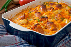 Casserole with sausage, bacon and apples Royalty Free Stock Photo