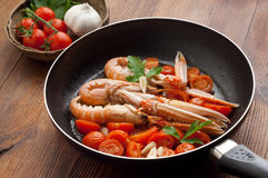 Casserole with scampi and tomatoes Stock Photo