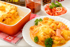 Casserole with smoked salmon, potatoes, leek and cheese. Stock Photography