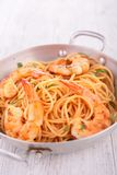 Casserole with spaghetti and shrimps Stock Images