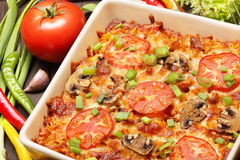 Casserole with tomato and mushrooms Stock Photography