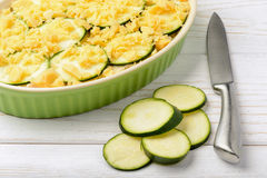 Casserole with zucchini, chicken and cheese before cooking. Stock Image