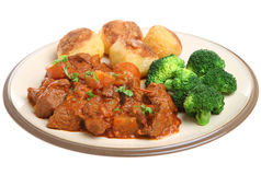 Casseroled Beef with Vegetables. Casseroled beef stew with roast potatoes and broccoli Royalty Free Stock Photography