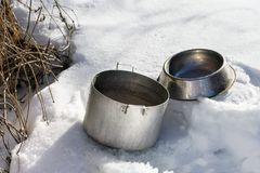 Casseroles Filling With Snow