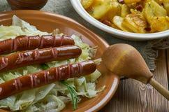 Casseruola della patata del cavolo della salsiccia Fotografia Stock