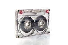 Cassete de banda magnética no fundo Fotos de Stock Royalty Free