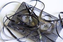 Cassete de banda magnética Unravelled Imagens de Stock Royalty Free