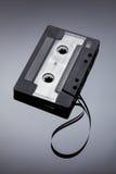 Cassetta d'annata su un fondo riflettente Immagine Stock Libera da Diritti