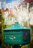 Cassetta delle lettere con le lettere che escono Immagine Stock Libera da Diritti