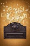 Cassetta delle lettere con le lettere che escono Fotografia Stock Libera da Diritti