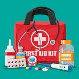 Cassetta di pronto soccorso medica con le pillole ed i dispositivi Immagini Stock