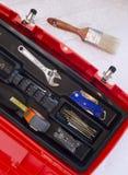 Cassetta portautensili arancio con nastro adesivo e la spazzola crescenti Fotografie Stock Libere da Diritti