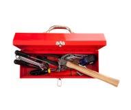 Cassetta portautensili rossa del metallo con gli strumenti su bianco Fotografia Stock
