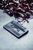 Cassette. Old trashed audio c cassette. Short depth of field Stock Photography