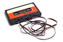 Cassette. Old audio cassette and its curly tape Royalty Free Stock Image