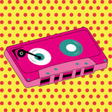 Cassette. Abstract pink cassette on special pop art background Royalty Free Stock Photos