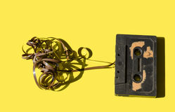 Cassette on a colored background yellow retro Royalty Free Stock Photo