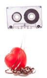 Cassette de bande audio et un coeur rouge Photographie stock libre de droits