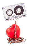 Cassette de bande audio et un coeur rouge Photographie stock