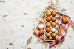 The cassette with eggs, hay and whisk Royalty Free Stock Photography