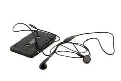 Cassette and headphones Stock Photos